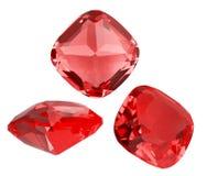 Três gemas vermelhas do rubi no branco Imagens de Stock Royalty Free