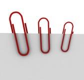 Três grampos vermelhos ilustração do vetor