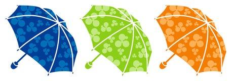 Três guarda-chuvas brilhantes Foto de Stock Royalty Free