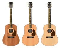 Três guitarra com uma textura de madeira Foto de Stock