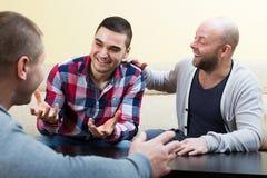 Três homens adultos imagens de stock