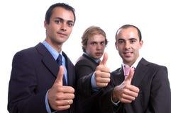 Três homens de negócio positivos Fotos de Stock