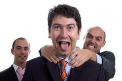 Três homens de negócio violentos Imagem de Stock