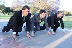 Três homens de negócios novos em um começo Foto de Stock