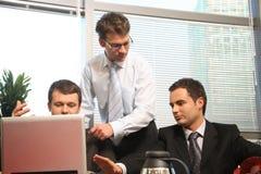 Três homens na reunião de negócio fotografia de stock royalty free
