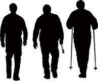 Três homens que andam, vetor do alpinista da silhueta Imagem de Stock Royalty Free