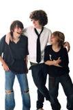 Três irmãos que riem junto foto de stock royalty free