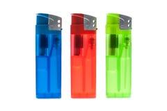 Três isqueiros da cor Foto de Stock Royalty Free