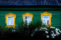 Três janelas amarelas Imagens de Stock