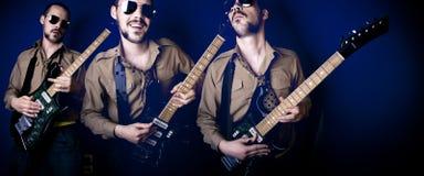 Três jogadores de guitarra Fotos de Stock