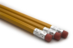 Três lápis amarelos imagens de stock