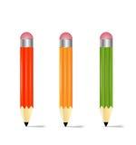 Três lápis em um fundo branco Fotografia de Stock
