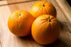 Três laranjas Fotos de Stock