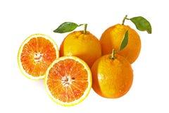 Três laranjas com dois halfs Imagens de Stock Royalty Free