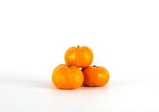 Três laranjas no fundo branco Fotografia de Stock