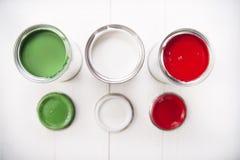 Três latas da pintura Foto de Stock