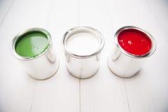 Três latas da pintura Imagem de Stock