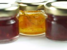 Três latas do doce de fruta Fotografia de Stock Royalty Free