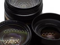 Três lentes das câmeras de reflexo imagens de stock