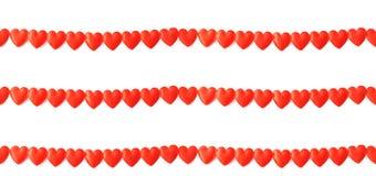 Três linhas de corações de seda vermelhos no branco Fotos de Stock Royalty Free
