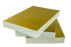 Três livros dourados Imagem de Stock