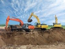 Três máquinas escavadoras Imagens de Stock Royalty Free