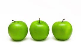 Três maçãs verdes frescas Fotografia de Stock