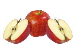 Três maçãs vermelhas isoladas Imagem de Stock
