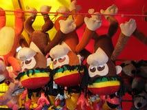 Três macacos em uma mostra Fotografia de Stock