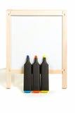 Três marcadores e whitebord Imagens de Stock