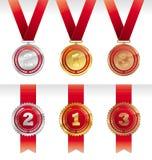 Três medalhas - ouro, prata e bronze Fotos de Stock Royalty Free