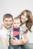 Três membros da família caucasianos junto Imagem de Stock