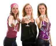 Três meninas bonitas que comemoram Fotos de Stock