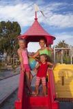 Três meninas no campo de jogos Fotos de Stock Royalty Free
