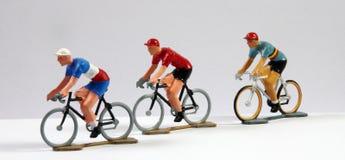Três metal Cyclists modelo imagem de stock