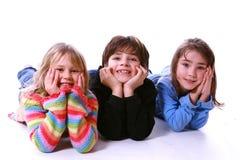 Três miúdos fotos de stock