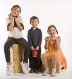 Três miúdos em uma fileira Imagens de Stock Royalty Free