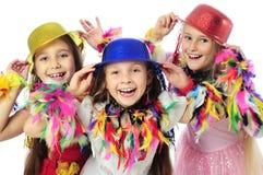 Três miúdos engraçados do carnaval Imagens de Stock Royalty Free