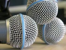 Três microfones Fotografia de Stock