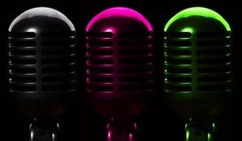 Três microfones Imagem de Stock Royalty Free