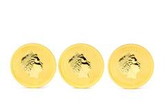 Três moedas de ouro eretas do dólar Fotos de Stock