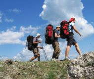 Três montanhistas Foto de Stock
