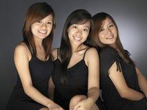 Três mulheres asiáticas novas bonitas Fotografia de Stock