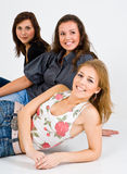 Três mulheres de sorriso   Foto de Stock