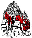 Três mulheres elegantes novas que compram em Londres ilustração royalty free