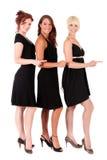 Três mulheres enegrecem vestidos imagens de stock