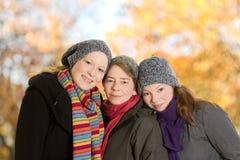 Três mulheres que inclinam junto outubro imagem de stock royalty free