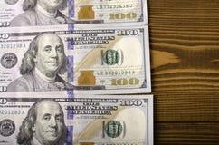 Três notas com valor nominal de $ 100 Imagem de Stock