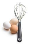 Três ovos e batedores de ovos imagem de stock royalty free