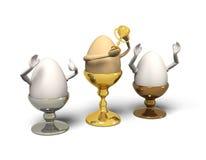 Três ovos em uns eggcups são vencedor. Imagens de Stock Royalty Free
